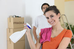 Couple cleaning house Royalty Free Stock Image