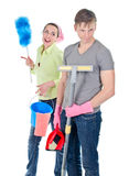 Couple cleaning the house. Angry men and smiling women doing spring cleaning in the house Royalty Free Stock Photo