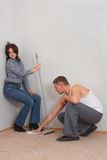 Couple is cleaning a new flat. Some flirtation... Stock Photo