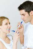 Couple cleaning teeth Royalty Free Stock Photography