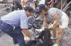 Couple cleaning up after 1992 riots. South Central Los Angeles, California Stock Photography