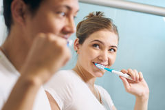 Couple Cleans Teeth Man And Woman Together In Bathroom Stock Photography