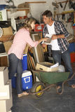 Couple Clearing Garage For Yard Sale Stock Photo