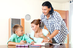 Couple with clever  teenager doing homework Stock Photo