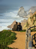 Couple on a cliff Royalty Free Stock Photos