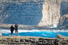 Couple on the cliffs of San Lawrenz, Gozo, Malta.  Royalty Free Stock Photos