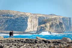 Couple on the cliffs of San Lawrenz, Gozo, Malta.  Stock Image
