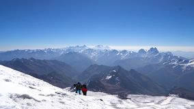Couple of Climbers in crampons coming up to the summit of Elbrus in Caucasus mountains. Snow peak. stock video footage