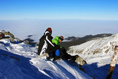 Couple of climbers having a brake on Peleaga peak in Retezat mountains, Romania Royalty Free Stock Photography