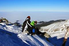 Couple of climbers having a brake on Peleaga peak in Retezat mountains, Romania Royalty Free Stock Photography