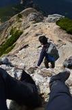 Couple climbing a mountain Royalty Free Stock Photo