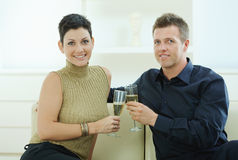Couple clinking with champagne Royalty Free Stock Image