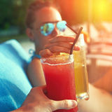 Couple clinking glasses with cocktails Royalty Free Stock Image