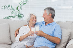 Couple clinking glasses of milk Stock Photos
