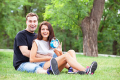 Couple with clock Royalty Free Stock Images