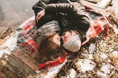 Couple close lying on plaid in winter park Stock Images