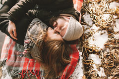 Couple close lying on plaid in winter park Royalty Free Stock Photography