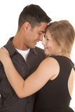 Couple close ready to kiss dark outfits Royalty Free Stock Photography