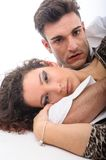 Couple close together on the floor Royalty Free Stock Photo