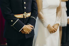 Groom and bride close up view of hands during ceremony. Stock Photography
