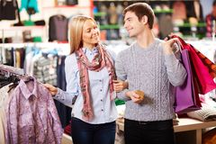 Couple in clothes department Royalty Free Stock Photo