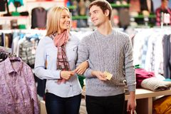 Couple in clothes department Royalty Free Stock Images