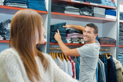 Couple in clothes shop. Couple in a clothes shop Stock Image
