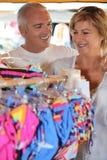 Couple clothes shopping Royalty Free Stock Photos