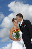 Couple in clouds. A bride and groom on their wedding day Stock Images