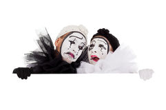 Two clowns are crying and sad. A couple of clowns are crying and sad Royalty Free Stock Photography
