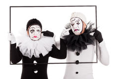 Two clowns in a frame cant hear each other Royalty Free Stock Image