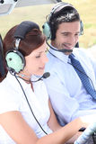 Couple in the cockpit. Of a light aircraft Stock Photos