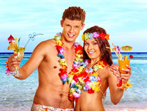 Couple with cocktail at Hawaii wreath beach Royalty Free Stock Photography