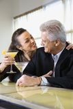 Couple with cocktails. Stock Photos