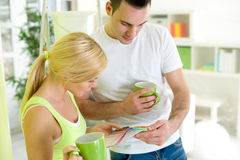 Couple on coffee break  with samples of paint colors Stock Image