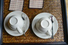 Couple coffee cups set on tray. Royalty Free Stock Photo