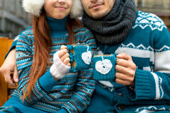 Couple with coffee cups in winter Royalty Free Stock Photo