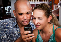 Couple in Coffee House with Cell Phone Stock Images