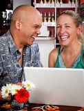 Couple in Coffee House with Laptop Computer Royalty Free Stock Image