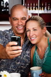 Couple in Coffee House Taking Self-Portrait Royalty Free Stock Image
