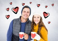 Couple with coffee mugs against white background with hearts Stock Photos