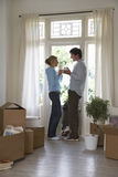 Couple With Coffee Mugs At Window By Boxes Stock Photo