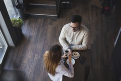 Couple in a coffee shop having a conversation royalty free stock photo