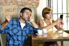 Couple at coffee shop  mobile phone addict woman ignoring frustrated man asking for help Stock Photo