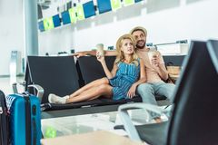 Couple waiting for boarding at airport Stock Image