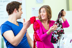 Couple in a coin laundry washing Stock Photography