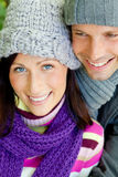 Couple coldness. Embracing romantic couple in cold weather time with warm clothes cap and scarf royalty free stock image