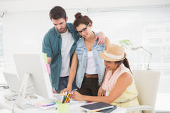 Couple with colleague working with colour wheel Royalty Free Stock Image