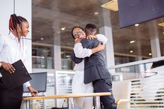 Couple collecting new car from salesman on lot. Couple collecting a new car from salesman on lot stock images
