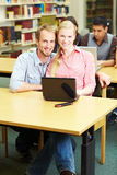Couple in college Royalty Free Stock Images